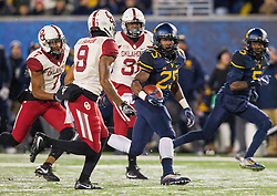 Nov 19, 2016; Morgantown, WV, USA; West Virginia Mountaineers running back Justin Crawford (25) runs the ball during the second quarter against the Oklahoma Sooners at Milan Puskar Stadium. Mandatory Credit: Ben Queen-USA TODAY Sports