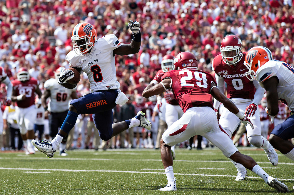 FAYETTEVILLE, AR - SEPTEMBER 5:  Autrey Golden #8 of the UTEP Miners runs the ball in for a touchdown during a game against the Arkansas Razorbacks at Razorback Stadium on September 5, 2015 in Fayetteville, Arkansas.  (Photo by Wesley Hitt/Getty Images) *** Local Caption *** Autrey Golden