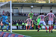 Forest Green Rovers Carl Winchester(7) heads the ball towards goal and cleared off the line by Cheltenham Town's Jonny Mullins(5) during the EFL Sky Bet League 2 match between Forest Green Rovers and Cheltenham Town at the New Lawn, Forest Green, United Kingdom on 20 October 2018.