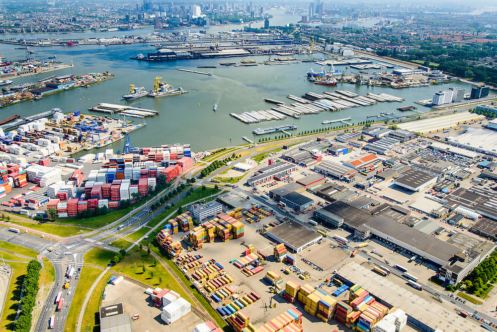 Nederland, Zuid-Holland, Rotterdam, 10-06-2015;  Waalhaven (WestZijde) gezien naar rivier de Nieuwe Maas en skyline Rotterdam centrum. United Waalhaven Terminals (UWT) container terminal in de voorgrond.<br /> Waal harbour (West side) seen in the direction of Nieuwe Maas river and the skyline of Rotterdam.<br /> luchtfoto (toeslag op standard tarieven);<br /> aerial photo (additional fee required);<br /> copyright foto/photo Siebe Swart