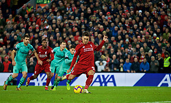 LIVERPOOL, ENGLAND - Saturday, December 29, 2018: Liverpool's Roberto Firmino scores the fifth goal from a penalty kick, completing his hat-trick, during the FA Premier League match between Liverpool FC and Arsenal FC at Anfield. (Pic by David Rawcliffe/Propaganda)
