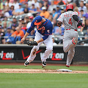 Lucas Duda, New York Mets, makes the out at first base as  Brandon Phillips, Cincinnati Reds, reaches for the base during the New York Mets Vs Cincinnati Reds MLB regular season baseball game at Citi Field, Queens, New York. USA. 28th June 2015. Photo Tim Clayton