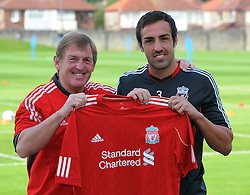 LIVERPOOL, ENGLAND - Thursday, August 18, 2011: Liverpool's new signing Jose Enrique with manager Kenny Dalglish during a photo call at the club's Melwood Training Ground. (Pic by Pool/Liverpool FC/Propaganda)