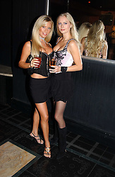 Left to right, NATHALIE DENNING and MISS ANOUSHKA DE GEORGIOU at a party to celebrate a new collection of sexy underware by Janet Reger called 'Naughty Janet' held at 5 Cavendish Square, London on 19th October 2004.<br />