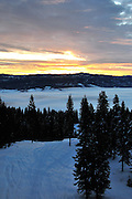 USA, Idaho, Valley County, Donnelly, Tamarack Resort, Sunrise over Long Valley and Payette River Mountains from atop West Mountain's ski slopes