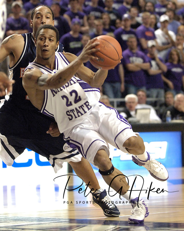 Kansas State Mario Taybron (22) drives into the paint against pressure from Cal State Fullerton's Vershan Cottrell, during the second half at Bramlage Coliseum in Manhattan, Kansas, November 30, 2005.  K-State beat Titans of Cal State Fullerton 84-59.