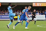 AFC Wimbledon striker Joe Pigott (39) with a shot on goal during the EFL Sky Bet League 1 match between AFC Wimbledon and Coventry City at the Cherry Red Records Stadium, Kingston, England on 11 August 2018.