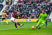 Craig Halkett (#26) of Heart of Midlothian FC sees his shot on goal saved by Joe Lewis (#1) of Aberdeen FC during the Ladbrokes Scottish Premiership match between Heart of Midlothian FC and Aberdeen FC at Tynecastle Stadium, Edinburgh, Scotland on 29 December 2019.