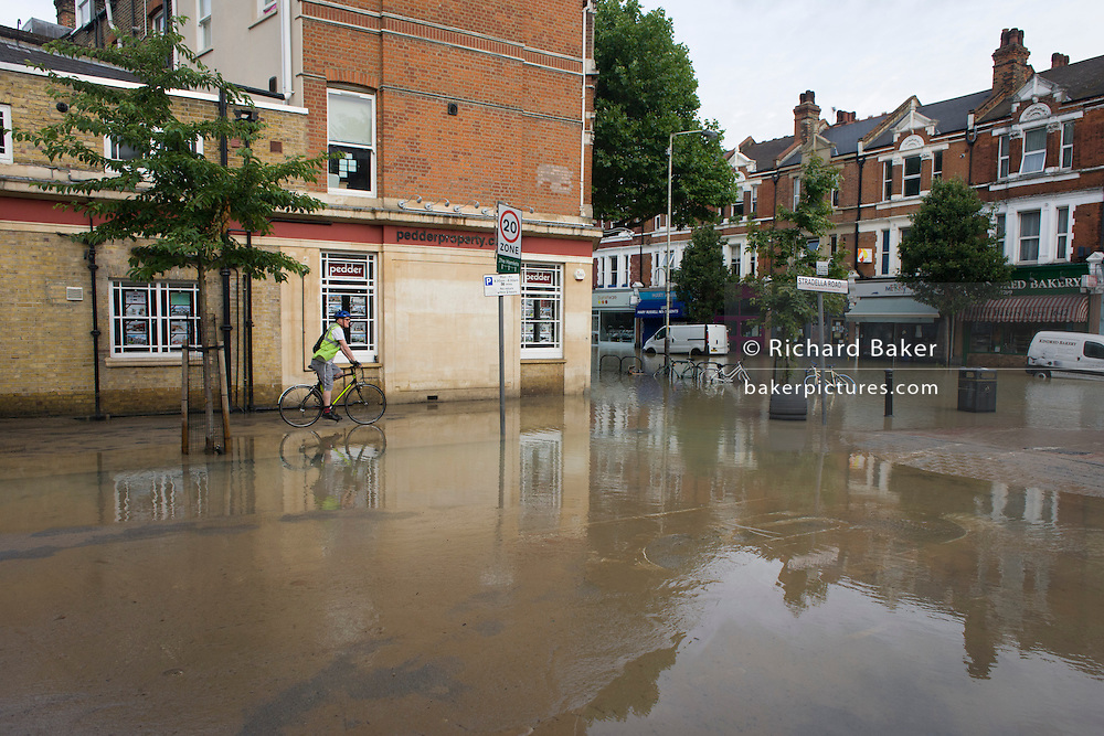 Local businesses forced to close after a burst water main closed the otherwise busy junction of Half Moon Lane and Dulwich Road in the south London area of Herne Hill. At about 5am, emergency crews were called when water inundated local homes and businesses, forcing residents to evacuate their properties and leave before electricity supplies were shut down.