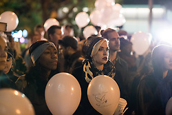 October 20, 2016 - Chicago, United States - People hold balloons to represent each life lost to gun violence in 2016 during a Laquan Day rally in Chicago on October 20, 2016. Over 200 people gathered outside Chicago Police Headquarters to commemorate the life of 17-year-old police shooting victim Laquan McDonald on the two year anniversary of his death. (Credit Image: © Max Herman/NurPhoto via ZUMA Press)