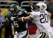 Baylor's Antwan Goodley (5) stiffarms Washington's Justin Glenn during game action of the 2011 Valero Alamo Bowl at the Alamodome in San Antonio, Texas on Thursday, Dec. 29, 2011. Baylor won 67-56.
