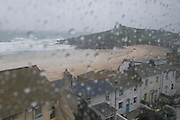 Looking down over Porthmeor beach in wet weather, St Ives, Cornwall, UK