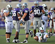 MANHATTAN, KS - AUGUST 30:  MANHATTAN, KS - August 30:  Defensive end Ian Campbell #98 of the Kansas State Wildcats celebrates with teammates Olu Hall #56 and Eric Childs #90 after sacking quarterback Giovanni Vizza #15 of the North Texas Mean Green in the second quarter on August 30, 2008 at Bill Snyder Family Stadium in Manhattan, Kansas.  (Photo by Peter G. Aiken/Getty Images)