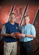Cleveland Browns special teams coach Chris Tabor with Columbia College women's basketball coach Mike Davis at Cleveland Browns headquarters in Berea, OH on Friday, June 17, 2011.