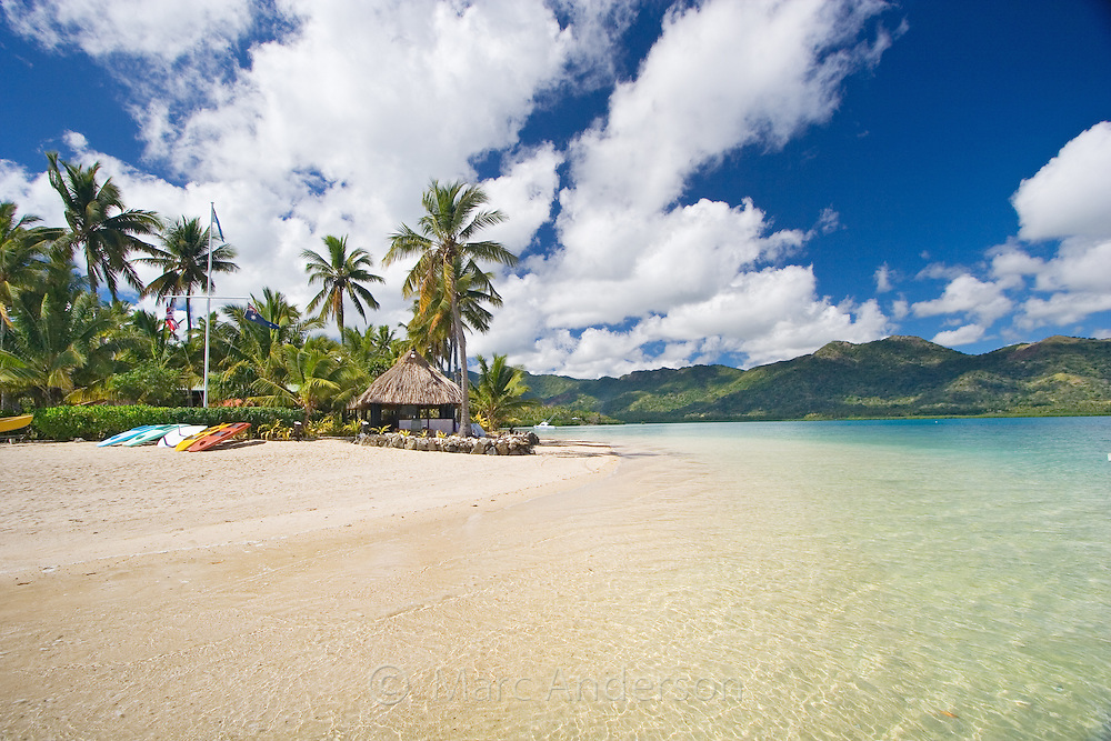 Beautiful clear water and a white sandy beach on a tropical island in Fiji.