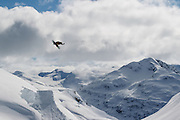 Mark Sollors does a huge method air on a hip jump in Rutherford, a backcountry snowmobile zone north of Whistler, British Columbia. This photo was on the cover of King Snow magazine.