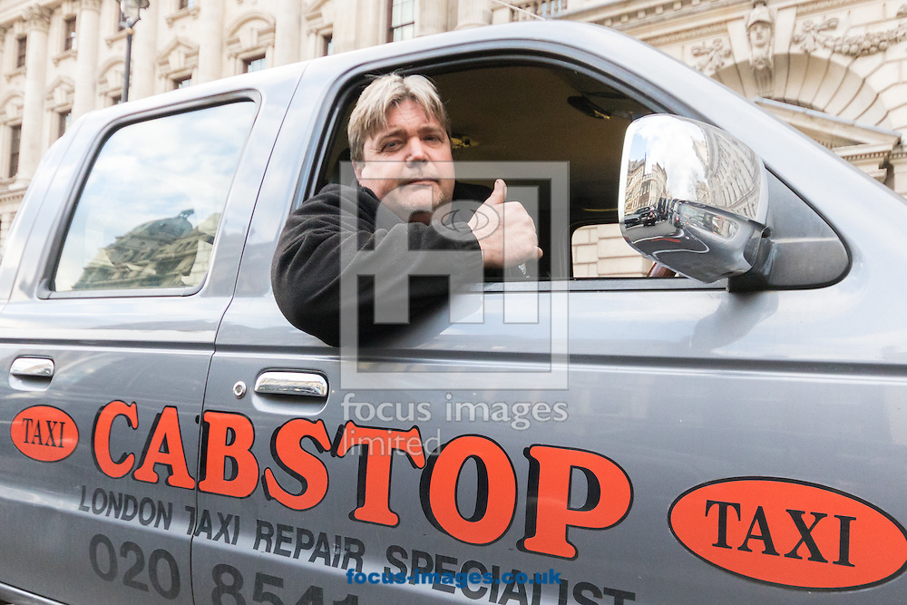A taxi garage owner joins striking drivers as an estimated 8,000 cabbies protest against &quot;unfair competition&quot; from Uber mini cabs<br /> Picture by Paul Davey/Focus Images Ltd +447966 016296<br /> 10/02/2016