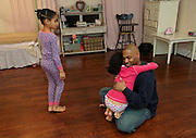 Shaun Alexander hugs daughter Heaven, 10, as they get ready for bedtime with his children in their home in Great Falls, VA. January 21, 2014.