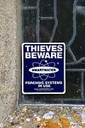 Smartwater Thieves Beware notice, church of Saint Mary, Swilland, Suffolk, England, UK