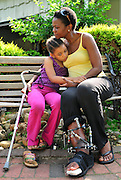 With her daughter by her side, Myrianne Pierre, who suffered a broken leg from the earthquake in Haiti, remembers loved ones that were killed and the weeks of suffering she withstood as she struggled to survive.
