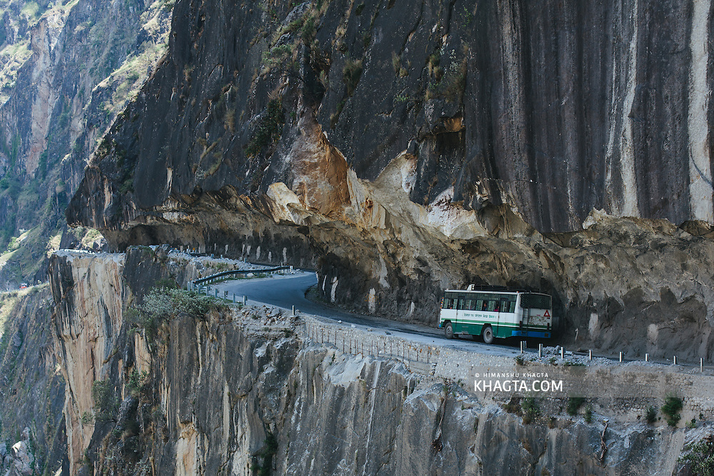 An HRTC Bus travelling across  Tranda Dhank, one of world's most dangerous roads.