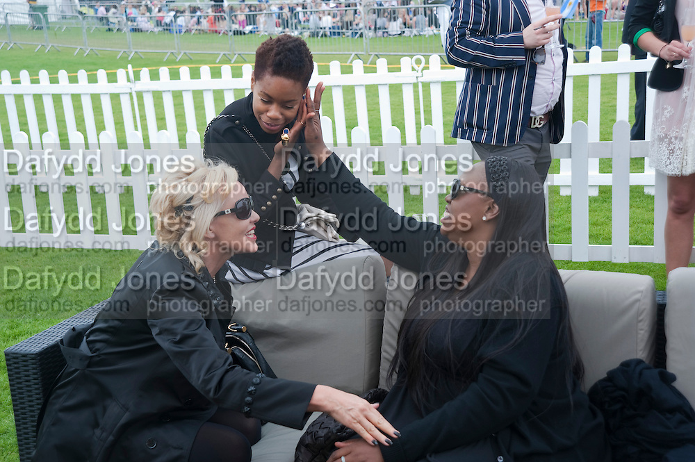 Amanda Eliasch; Tolula Adeyemi; Cartier International Polo Day at the Guards Polo Club. Windsor. July 26  2009
