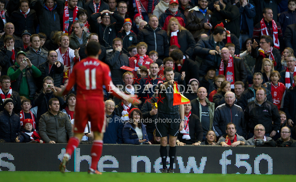 LIVERPOOL, ENGLAND - Boxing Day Monday, December 26, 2011: Liverpool's Maximiliano Ruben Maxi Rodriguez is flagged off-side by the assistant referee against Blackburn Rovers during the Premiership match at Anfield. (Pic by David Rawcliffe/Propaganda)