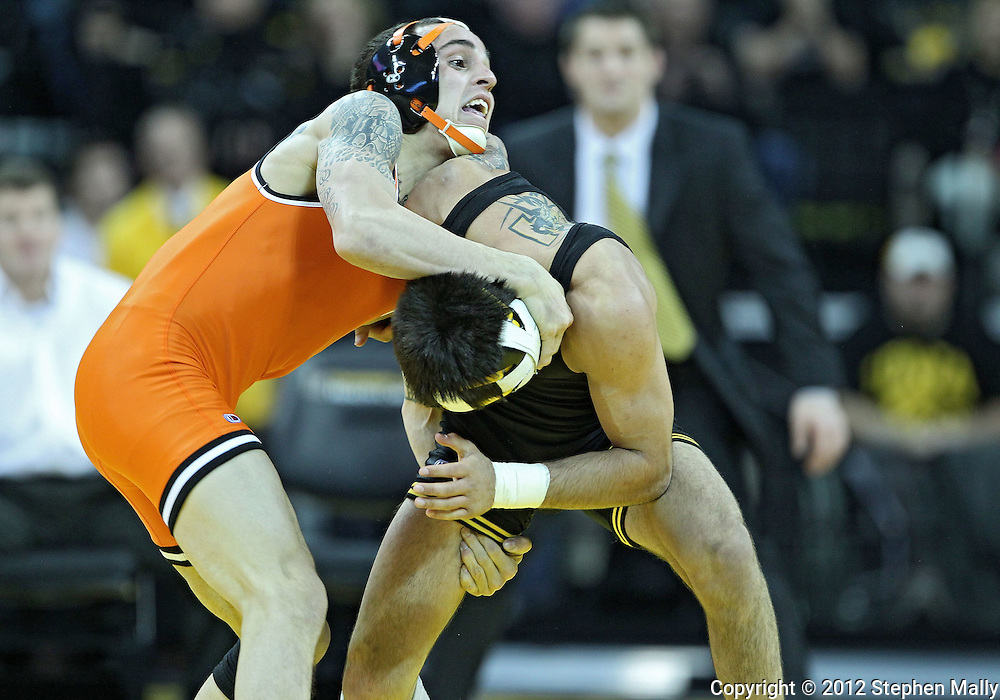 January 07, 2011: Oklahoma State's Jordan Oliver and Iowa's Tony Ramos battle for control during the 133-pound bout in the NCAA wrestling dual between the Oklahoma State Cowboys and the Iowa Hawkeyes at Carver-Hawkeye Arena in Iowa City, Iowa on Saturday, January 7, 2012. Ramos won 4-3.