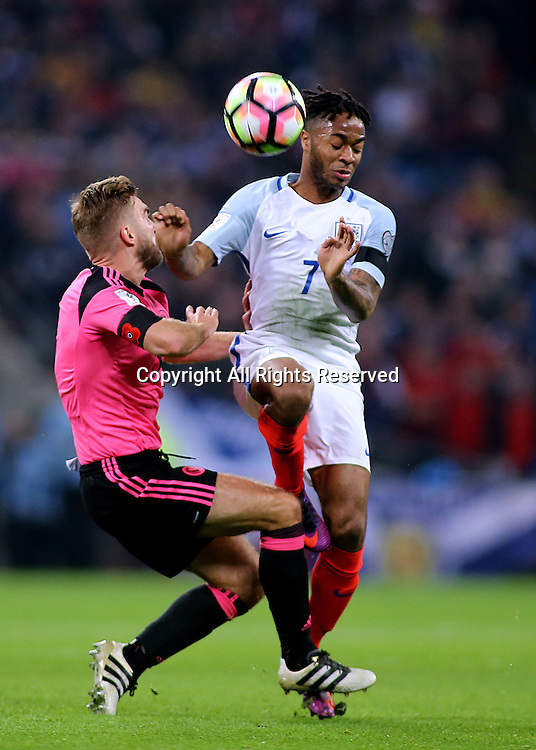 11.11.2016. Wembley Stadium, London, England. World Cup Qualifying Football. England versus Scotland. Raheem Sterling of England clashes with James Morrison of Scotland during a challenge