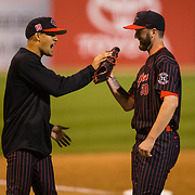 16 February 2018: San Diego State baseball opened up the season against UCSB at Tony Gwynn Stadium. San Diego State pitcher Daniel Ritcheson (30) is congratulated by a teammate after pitching a scoreless 7th inning. The Aztecs beat the Gauchos 9-1. <br /> More game action at sdsuaztecphotos.com