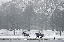 © Licensed to London News Pictures. 03/03/2018. London, UK. Horses being ridden through a winter landscape in Hyde Park, London. Large parts of the UK are recovering from a week of sub zero temperatures and heavy snowfall, following two severe cold fronts. Photo credit: Ben Cawthra/LNP