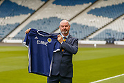 Steve Clarke arrives at the National Stadium, Hampden Park to meet the press following his appointment as the Scotland National Team head coach along pictured pitch side holding the Scotland Nation Team Shirt with his name on it, Glasgow, United Kingdom on 21 May 2019.