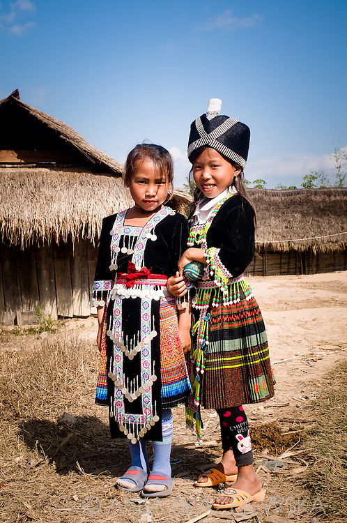 Laos, Muang Sing. Two Hmong girls wearing beautiful dresses because of the Hmong New Year's festival.
