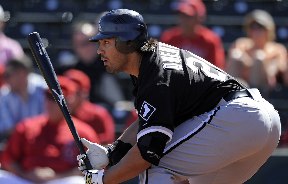 TEMPE, AZ - FEBRUARY 25:  Carlos Quentin #20 of the Chicago White Sox bats during the game against the Los Angeles Angels on February 25, 2009 at Tempe Diablo Stadium in Tempe, Arizona. (Photo by Ron Vesely)