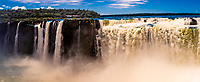 Panoramic view of Devil's Throat, the largest of the waterfalls at Iguazu Falls (Iguacu in Portugese), on the border of Brazil and Argentina. It is one of the New 7 Wonders of Nature and is a UNESCO World Heritage Site. There are 275 waterfalls total which make up the largest waterfalls in the world.  It is on the Argentine side.