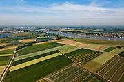 Nederland, Gelderland, Gemeente Brakel, 08-07-2010; Buitenpolder Het Munnikeland, links de Afgedamde Maas, rechts en aan de horizon de Waal. In het kader van het programma Ruimte voor de Rivier zijn er plannen om de polder weer als komgebied te gaan gebruiken voor de opvang van water bij hoge waterstanden. De Waalkade wordt verlaagd. .Polder Munnikenland, left the Afgedamde Maas (Meuse), river Waal right and at the horizon. Under the program 'space for the river', there are plans to use the polder as retaining basin during high water.  The height of the dike of the river Waal (right) will be reduced..luchtfoto (toeslag), aerial photo (additional fee required).foto/photo Siebe Swart
