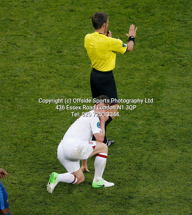 11/06/2012 European football championships. France v England.<br /> Scott Parker holds his nose as he kneels behind the referee.<br /> Photo: Mark Leech.