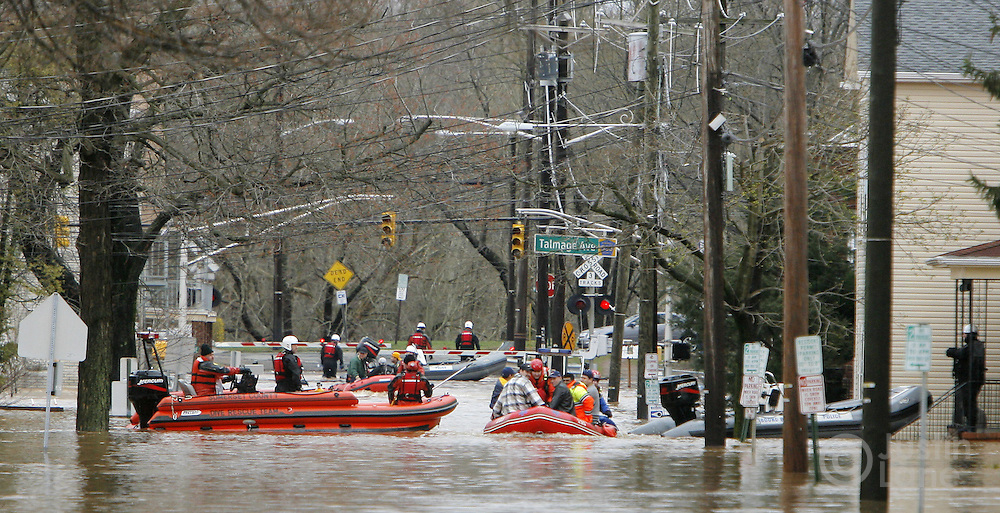 Firefighters help stranded residents evacuate a flooded area of Bound Brook, New Jersey on Monday 16 April 2007. A large storm delivered records amount of rain to the East Coast of the United States over the weekend and today, causing New Jersey to declare a state of emergency.