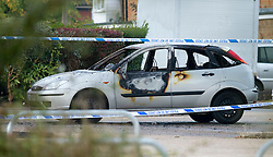 ©  London News Pictures. 15/10/2012. Harlow, UK. A burnt out car  on Barn Mead, Harlow, Essex where three children and a woman have died and three others are in hospital following a house fire. Two boys aged 13 and six, a girl aged 11 and the woman were declared dead at the scene. A nine-year-old boy and a three-year-old girl have serious burns and a man has minor burns. Photo credit : Ben Cawthra/LNP