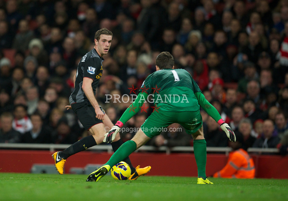 LONDON, ENGLAND - Wednesday, January 30, 2013: Liverpool's Jordan Henderson chips Arsenal's goalkeeper Wojciech Szczesny during the Premiership match at the Emirates Stadium. (Pic by David Rawcliffe/Propaganda)