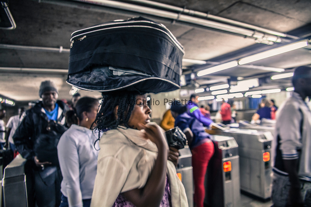 Haitian immigrants travel by metro to the Casa do imigrante, a shelter managed by the Catholic church in Liberdade neighbourhood in São Paulo