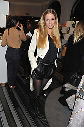FLORENCE BRUDENELL-BRUCE at a party to celebrate the launch of a limited edition shoe The Chambord in celebration of Nicholas Kirkwood's partnership with Chambord black raspberry liqueur, held at the Nicholas Kirkwood Boutique, 5 Mount Street, London on 12th December 2012.