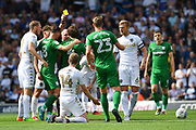 Preston North End midfielder Ben Pearson (4) receives yellow card for bad tackle on Leeds United midfileder Eunan O'Kane (14) during the EFL Sky Bet Championship match between Leeds United and Preston North End at Elland Road, Leeds, England on 12 August 2017. Photo by Ian Lyall.