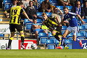 Chesterfield FC miffielder Jay O'Shea wins the ball from Burton Albion defender Damien McCrory during the Sky Bet League 1 match between Chesterfield and Burton Albion at the Proact stadium, Chesterfield, England on 26 September 2015. Photo by Aaron Lupton.