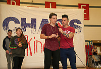 Chance Yourison donates his $100 egg to the American Breast Cancer charity during Recycled Percussion's takeover of the Laconia Middle School with Justin Spencer and Ryan Vezina (not pictured).   (Karen Bobotas/for the Laconia Daily Sun)