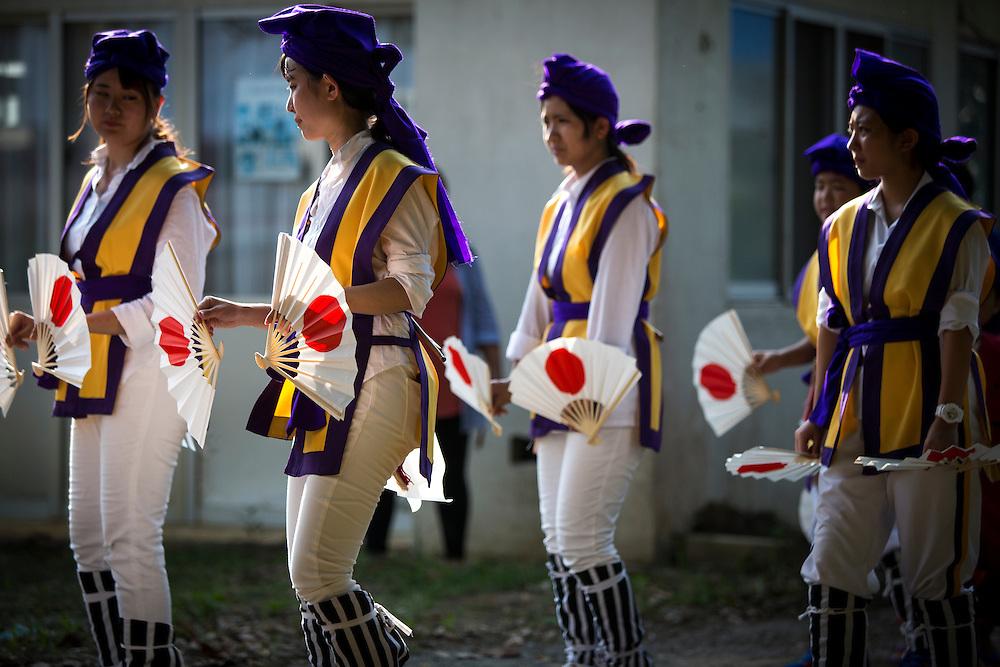 OKINAWA, JAPAN - AUGUST 17 : Local Eisa folk dancers perform a modern Eisa folk dance in Higashi village during the Obon festival to honour the spirits of their ancestors on August 17, 2016, Okinawa prefecture, Japan.  (Photo by Richard Atrero de Guzman/NURPhoto)