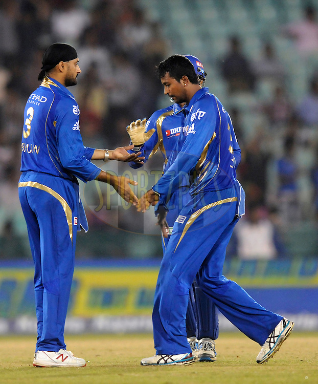 Harbhajan Singh of Mumbai Indians celebrates the wicket of BJ Watling of Northern Knights during the qualifier 5 match of the Oppo Champions League Twenty20 between the Southern Express and the Lahore Lions held at the Chhattisgarh International Cricket Stadium, Raipur, India on the 16th September 2014<br /> <br /> Photo by:  Pal Pillai / Sportzpics/ CLT20<br /> <br /> <br /> Image use is subject to the terms and conditions as laid out by the BCCI/ CLT20.  The terms and conditions can be downloaded here:<br /> <br /> http://sportzpics.photoshelter.com/gallery/CLT20-Image-Terms-and-Conditions-2014/G0000IfNJn535VPU/C0000QhhKadWcjYs