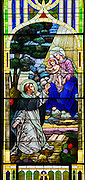 Stained glass image from St. Joseph Church in Kellnersville, Wis., depicts St. Dominic receiving rosary from Blessed Mother. (Sam Lucero photo)