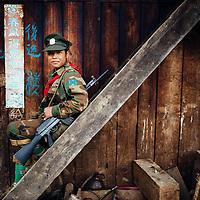 HSSU 20150409 TNLA kapinallisryhmä Shanin osavaltiossa, Myanmar. Potretti TNLA sotilaasta. Kuva: Benjamin Suomela