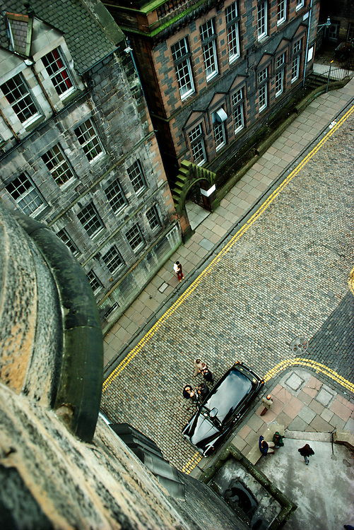 Taxi and cobble stone street, Edinburgh, Scotland.